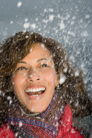 british ethnicity: A woman laughing in the snow