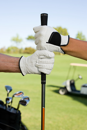 golf glove: People holding golf club