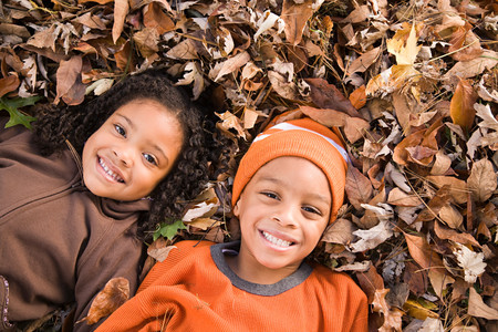 lying on leaves: Kids lying on leaves