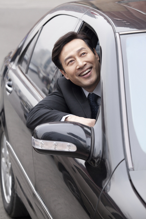 40 44 years: Businessman looking out car window