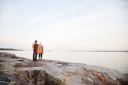 Mature couple standing on rocks together