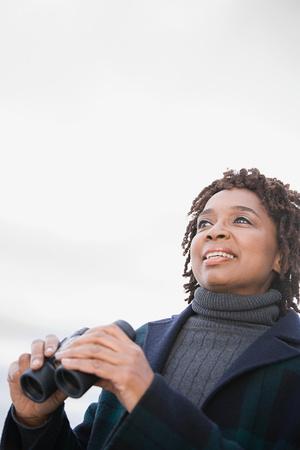 visions of america: One woman holding binoculars Stock Photo