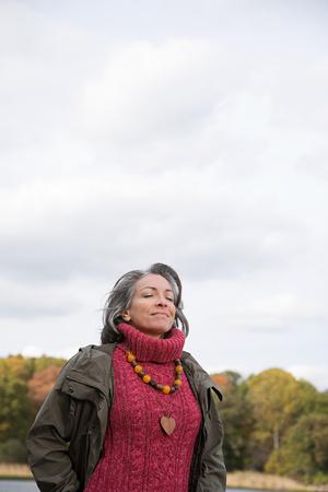 greying: Serene looking mature woman