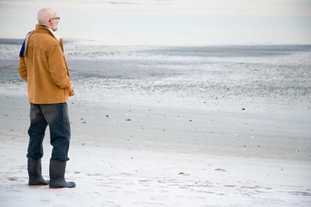 Mature man standing on an empty beach