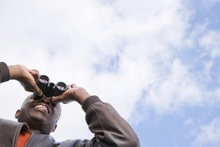 visions of america: One man looking through binoculars Stock Photo