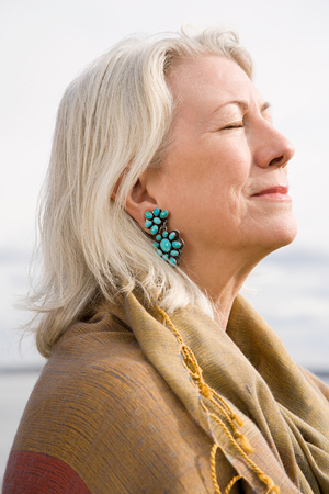 gray haired: Serene looking gray haired woman