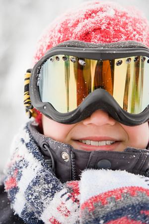 ski goggles: Boy wearing ski goggles Stock Photo