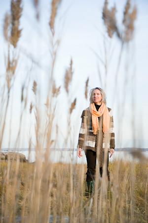 Woman standing on marshland Stock Photo