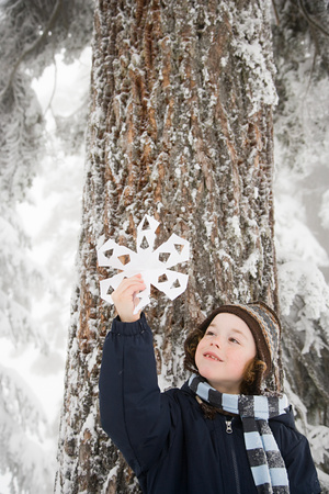 with snowflakes: Boy with a snowflake Stock Photo