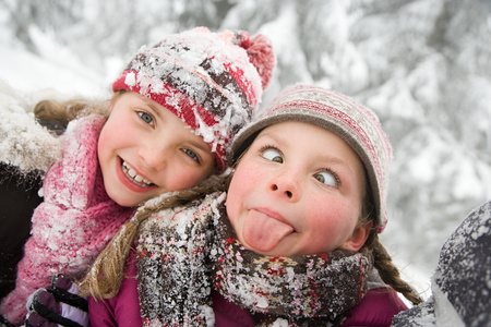 girl tongue: Girls in the snow Stock Photo