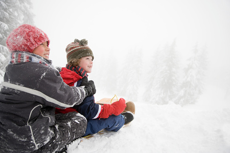 toboggan: Boys on toboggan Stock Photo