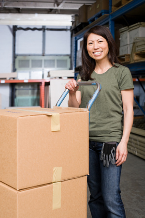 factory worker: Woman with cardboard boxes