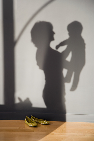 happy baby: shadow of a woman holding a baby