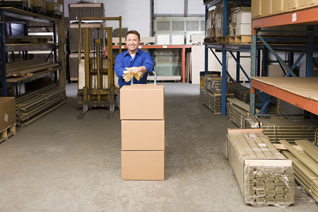 laborious: Worker in warehouse Stock Photo