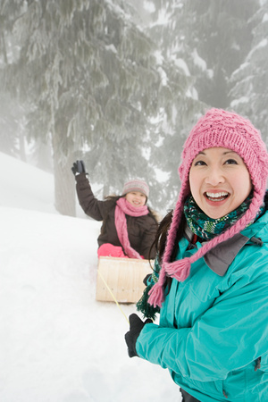 toboggan: Mother and daughter with toboggan