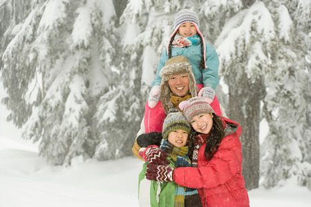 asian ethnicity: Family in the snow Stock Photo