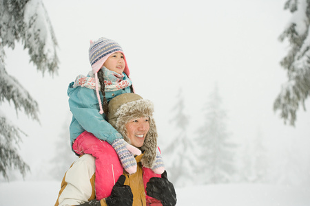 asian ethnicity: Father and daughter in snow