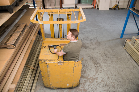 able to learn: Man in forklift truck