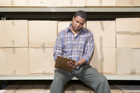 Man in warehouse Stock Photo