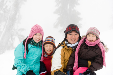 Family in the snow 写真素材