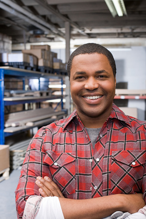 african ethnicity: Man in warehouse Stock Photo
