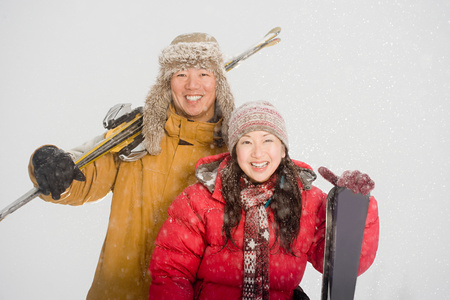 only mid adult men: Couple with skis