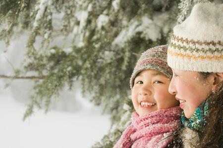 family outdoor: Mother and daughter in hats Stock Photo