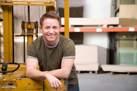leaning on the truck: Warehouse worker