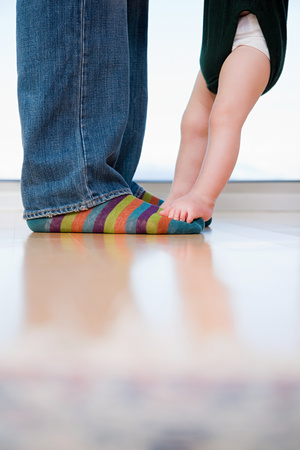 children learning: man and a babys feet Stock Photo