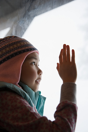 looking through: Girl looking through window Stock Photo