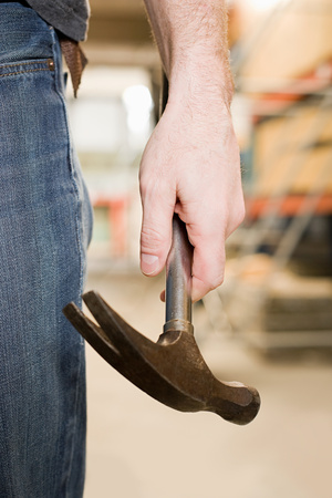 tradespeople: Person holding a hammer