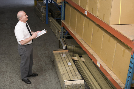 taking inventory: Man working in warehouse