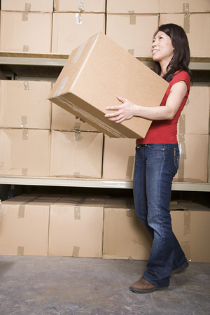 moving: Woman with cardboard boxes