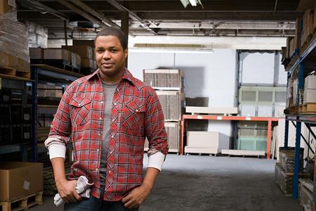 Man in warehouse 스톡 콘텐츠