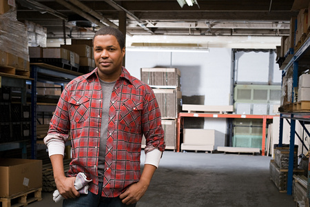 small business owner: Man in warehouse Stock Photo