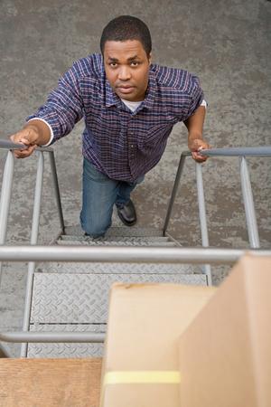 Man climbing steps Stock Photo