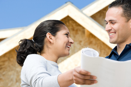home ownership: A couple holding a blueprint