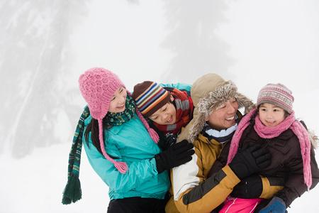 chinese women: Family having fun in winter