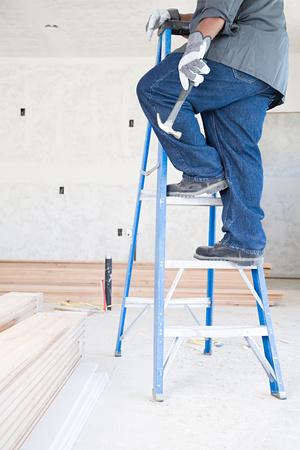 boned: A builder holding a hammer