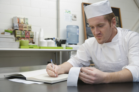 Chef doing accounts Banco de Imagens