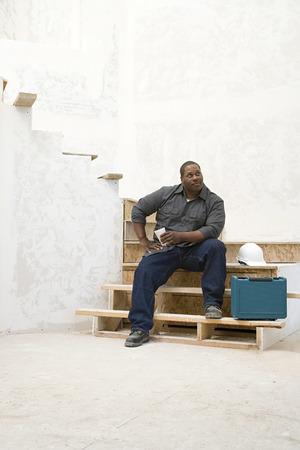 taking a break: A builder taking a break