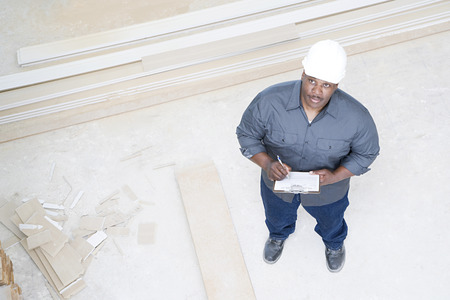inspecting: A builder inspecting a house