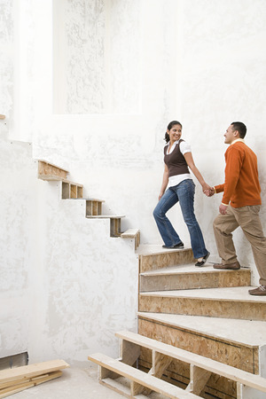 pacific islander ethnicity: A couple walking up stairs Stock Photo