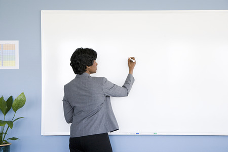 rasa: Businesswoman writing on whiteboard