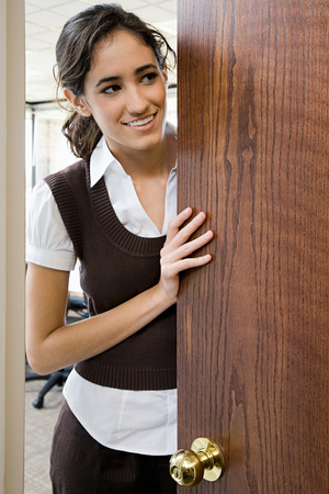 openings: Young woman by door