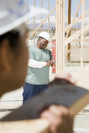 spirit level: A builder using a spirit level