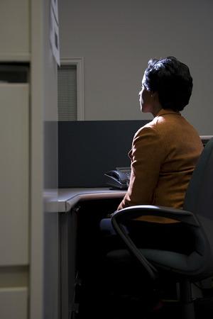 Woman in dark office