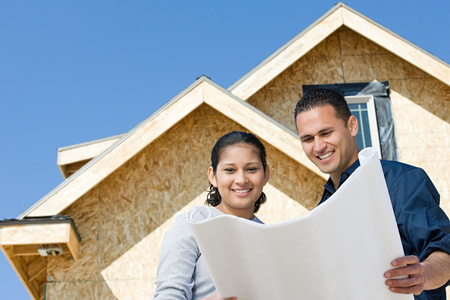 building a home: A couple looking at a blueprint