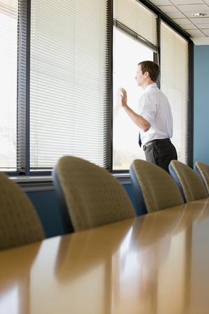 snooping: Office worker looking through window