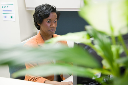 over worked: Woman working in office